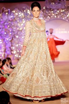 Cream and gold anarkali. Abu Jani and Sandeep Khosla presents The Golden Peacock Collection.