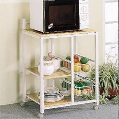 Check out the Coaster Furniture 2506 Kitchen White Serving Cart with 3 Shelves and 2 Storage Compartments  priced at $102.00 at Homeclick.com.