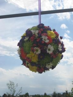 Hanging Flower Balls A Simple Accent To Any Ceremony Site Design By Beth Parker www.earlesflowers.com  Earle's Loveland Floral and Gifts   1421 N. Denver Ave Loveland, CO 80538  970.667.7550