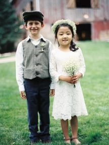 How precious are these little ones?! http://www.stylemepretty.com/little-black-book-blog/2015/08/28/rustic-romantic-wisconsin-barn-wedding/   Photography: Kate Weinstein - http://www.kateweinsteinphoto.com/