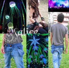 Marsupio di tessuto jeans con inserti di cotone, ha due tasche laterali e doppio bottone per regolare la circonferenza (è possibile aumentare il girovita allungando l'elastico che funge da asola - basterà inserire la lunghezza desiderata nelle note al momento dell'acquisto). Pratico, comodo e stiloso... avrete sempre le mani libere!!! :) 100% Riciclo Creativo -------------> Seguimi sul web: https://malicecraft.wordpress.com/  -------------> e su fb: https://www.facebook.com/MaliceCrafts