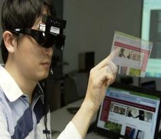 Hand gestures on Air, just like Tom Cruise did in the Hollywood flick Minority Report can be a reality soon. This new technology from Taiwan called the i-Air can project a virtual touch-based interface in the user's field of vision.