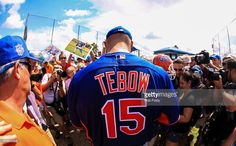 Tim Tebow #15 of the New York Mets signs autographs after a work out at an instructional league day at Tradition Field on September 20, 2016 in Port St. Lucie, Florida.