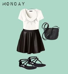 Glam up your plain white tee! Adding edgy black and white pieces gives a white tee a rocker-chic feel