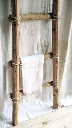 Leather tied primitive ladder...do something along these lines with thinner rungs for hanging magazines.