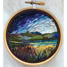 Russian artist Vera Shimunia creates colorful embroidery designs that look like pieces of landscape art. Using various embroidery stitches, each embroidery painting captures the vibrant beauty of nature. Embroidered flowers fill textile meadows, and the colors of mountains, fields, and seascapes blend like paint.