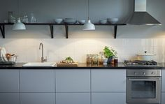 Use hanging pendant lamps to replace under cabinet lighting when you have open shelves
