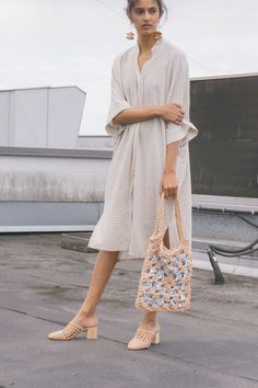 Two in one. The Priory Mune dress can be worn left open as a jacket or buttoned up as a dress. We love it accessorized with drop earrings, a statement tote and woven mules.