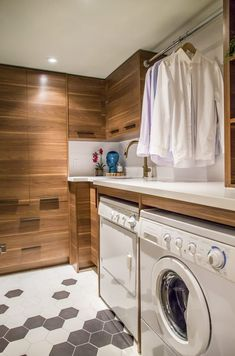 Must-Have Laundry Room Items Roundup- Beautiful laundry room design with wooden cabinetry and Pure White counters by Avenue Design, photo by Aia Photography Rustic Laundry Rooms, Laundry Decor, Small Laundry Rooms, Laundry Room Design, White Counters, Avenue Design, Room Closet, Interior Decorating, Home Appliances