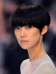 Japanese model Tao Okamoto, known for her daring bowl cut and androgynous look