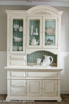 painted china cabinet - not sure I like the inside color... Or the white... it would very much depend on the home, but I love the shape and construction!