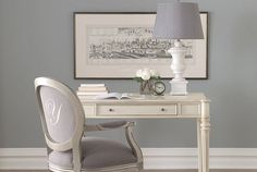 I love the blue gray wall and the classical lines of the lamp. It's french but not fussy, ooh la la!
