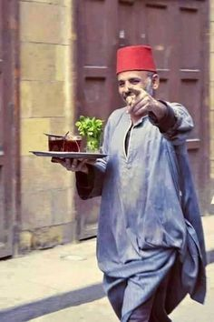 Tea with fresh mint served by an Egyptian waiter in Cairo