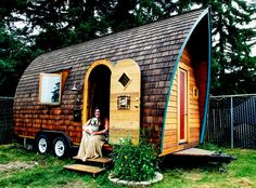 tiny house on wheels plans form curved walls the dominant brown wood with two doors - Tiny House Kits