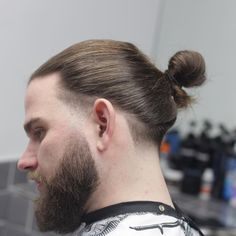 Today's hairstyles for men with long hair have come along way since the laughable scraggly ponytail. All of thesecool looks features 2017 hair trends just with longer hair. From chin length locks swept back to really - March 02 2019 at Man Bun Undercut, Undercut Long Hair, Man Bun Haircut, Man Bun Hairstyles, Trendy Mens Hairstyles, Men's Hairstyle, Long Hair Fade, Long Hair Cuts, Men With Long Hair