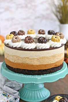 Pumpkin Chocolate Mousse Cake is a stunning 4-layer dessert with chocolate cake, cinnamon mousse, pumpkin-butterscotch mousse, and salted caramel mousse!!