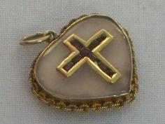 Gold garnet heart cross locket