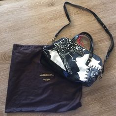 "Kate Spade handbag Fabric and patent leather Kate Spade black and cream purse. Can be carried by 14"" handles or by included patent leather strap. 15"" long, 11"" deep. Zip closure. One zippered pocket and two other pockets inside. Comes with dust bag. kate spade Bags Satchels"
