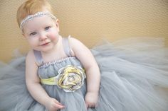 In LOVE with the styling!!!!  Gorgeous overflowing grey tutu, flower and crystal headband from Etsy.com. Photography by Krista Lee.  www.kristaleephotography.com