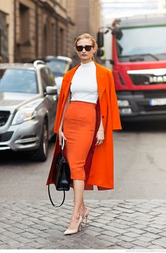 Orange trench coat and orange pencil skirt perfectly paired with a white round neck top