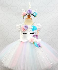 Like Us on Facebook and Follow us on instagram for Giveaways,Sales,and updates! Facebook- https://www.facebook.com/pinktoesnhairbows Instagram- http://instagram.com/pinktoesandhairbows How adorable is this unicorn tutu dress!!! Perfect for your little ones special day! Made with high