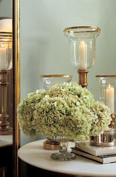 A bouquet of light green hydrangea alongside metallic Ralph Lauren Home accents