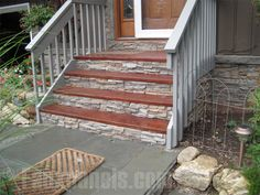 Photo: Our faux stone siding panels in Regency Stacked Stone is a quick and easy way to improve the look of the stair sides and facings. However, do not use it for the landing steps -- it's not rated for foot traffic.