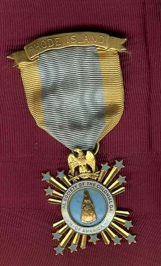 United States of America National Society of Colonial Dames of America Rhode Island Gold Badge with original ribbon and clasp, the name of the recipient inscribed on the reverse, very nice