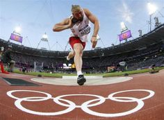 Poland's Tomasz Majewski competes in the men's shot put final during the London 2012 Olympic Games at the Olympic Stadium August 3, 2012. Majewski placed first ahead of Germany's David Storl who placed second and Reese Hoffa of the U.S who finished third. REUTERS-Kai Pfaffenbach