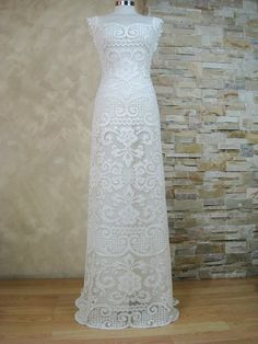 Wedding dress made from vintage the handmade knotted filet lace. The lace from soft breathable cotton make this dress elegant and comfortable to