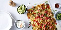 Our Easy Mexican Nachos with Greened-up Guac. You'll find plenty of nutritious veg and protein among the layers of crunchy chips and melty cheese. We've even greened up the guac with frozen peas. – I Quit Sugar Spinach Risotto, Risotto Rice, Mexican Nachos, Lentils And Rice, Green Lentils, Cooking Recipes, Healthy Recipes, Free Recipes, Savoury Recipes