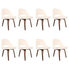 Set of Eight Early Eero Saarinen Dining Chairs | From a unique collection of antique and modern dining room chairs at https://www.1stdibs.com/furniture/seating/dining-room-chairs/