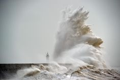 Waves crash over Newhaven Lighthouse on the south coast of England on Feb. 8 as the latest storm hits the country. Heavy winds buffeted Europe's northwestern flank forcing road closures and disrupting rail and ferry services in southern England and prompting high wave alerts in France's Brittany region. Gales and heavy rain with wind speeds of nearly 100 miles per hour (155 kilometres per hour) battered southern England and Wales, with flood warnings issued in more than 50 areas.
