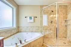 Large soaker tub and shower...