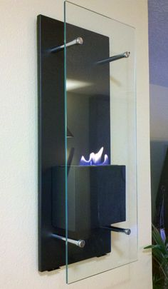 Plateia.co #ValoramoslaExcelencia #PlateiaColombia #diseño #design #diseñointerior #interiordesign Nu-Flame Wall Mounted Bio-Ethanol Fireplace - Cannello