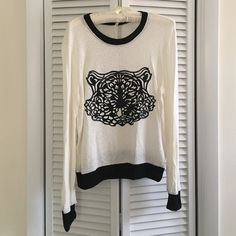 Tiger sweater by Moon Collection Adorable creme sweater with black tiger decal. Super comfy and fashionable! Moon Collection Sweaters Crew & Scoop Necks