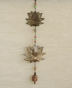Delightful lotus wind chime handmade with traditional Indian nana bells crafted using family-kept secret formula.  Made in India.