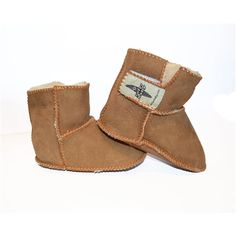 These sheepskin booties are made from the finest Australian Sheepskin. This soft and comfortable high-top shearling sheep skin boot will keep your baby or toddler warm while being in style. Feature a quick and easy velcro closure. Now your little one can have surf-style boots just like yours!