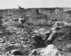 The moment of impact: French infantryman is struck by German rifle fire and begins his descent toward the ground. Three others seem to bypass the Germans in the trench. Battle of Verdun, Feb-December, 1916.