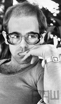 """Contemplation"", Elton John portrait by Terry O`Neill, 1975 #eyewear #lunettes #spectacles #seventies - Carefully selected by GORGONIA www.gorgonia.it"