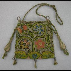 """Purse or bag, canvaswork embroidery 1600-1625 Origin: England W: 4""""; L: 3 5/8"""" Silk, silver metallic threads, linen ground, wood tassel forms Museum Purchase Acc. No. 1956-554"""