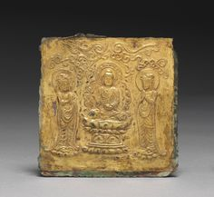 This plate is embossed with an image of the Amitabha Buddha flanked by two attendants. The plate, created by hammering softly from the back of the metal sheet, highlights the advanced metalworking