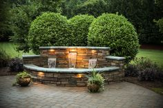 Outdoor Living -- Fountain made of stone. Approx 16' feet wide