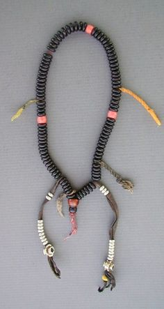 Superb old Mala Buddhist prayer beads from Tibet.  | Its made of 99 wooden beads and three pink-orange glass beads (imitation of the coral) and silver beads.