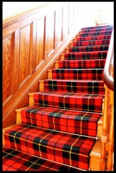 [I like the wainscoting as well as the stair runner. Notice the metal rods that keep the runner from slipping.] Tartan Stairs,so so lovely