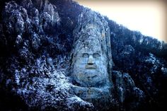"""christoph-liebe: """" Somewhere along the Danube River, near the city of Orsova, Southwest of Romania you can find this statue of the last barbarian king of the Dacians, Decebalus. Rock Sculpture, Lion Sculpture, Beautiful Places To Visit, Places To See, Romania Facts, Barbarian King, Visit Romania, Romania Travel, Carpathian Mountains"""