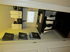Under-the-stairs closet part 2...the AFTER!  Finally a place the whole family can use daily.  Loved doing this project!