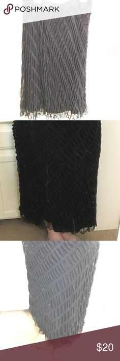 """Long black skirt Long, straight dressy skirt. It is dark black, though in some of the pics it looks lighter because of the flash. It has an elastic waist and is sheer with a black lining. It is light-weight, comfortable and pretty. It has no splits. It goes almost to my ankle, I'm 5' 3"""". John Paul Richard Skirts Pencil"""