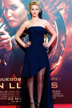 JENNIFER LAWRENCE At The Hunger Games: Catching Fire Madrid premiere, Jennifer Lawrence oozed elegance in a navy Christian Dior dress with a sheer skirt and edgy Anthony Vaccarello sandals. She styled her new pixie with roughed-up layers. Catching Fire, Madrid, Celebrity Red Carpet, Celebrity Style, Jeniffer Lawrance, Happiness Therapy, Jennifer Lawrence Photos, Christian Dior Dress, Navy Prom Dresses