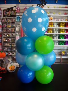 An air filled balloon centerpiece with a variety of colors and a polka dot on top!